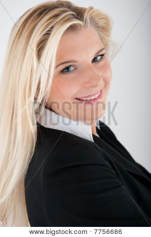 young beautiful business woman in black suit