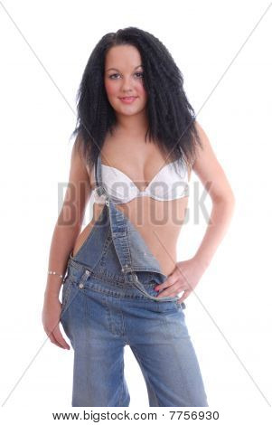 Sexy dark haired girl in bra and dungarees