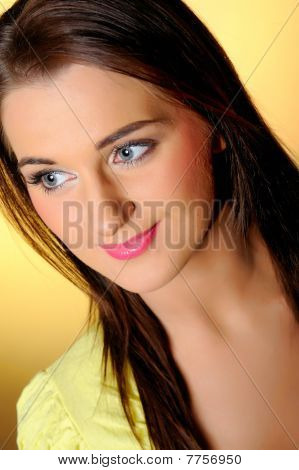 Portrait Of Pretty Relaxed Woman With Natural Make-up. Yellow Background