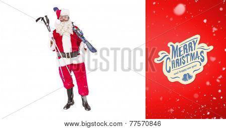 Santa claus holding ski and ski poles against red vignette