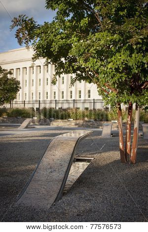 ARLINGTON, VA - SEPT 13, 2014: Lines of memorial units facing the Pentagon. Granite and stainless steel cantilevered benches have pools of water and names of each victim of the Sept 11, 2001 attack.