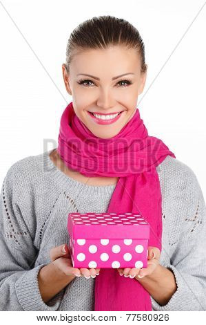 Beautiful girl with gift box in hands.