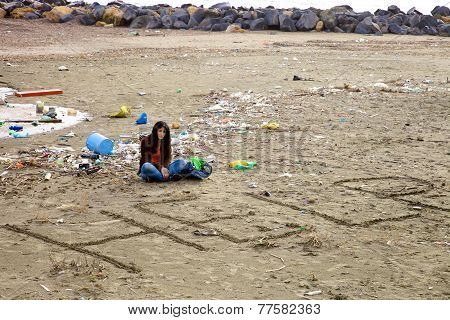 Woman Desperate About Dirt And Pollution On The Beach Asking For Help