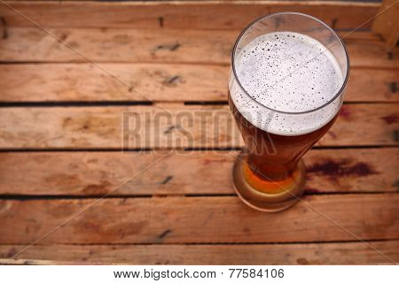 Tall Glass Of Beer In A Crate
