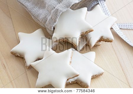 Cinnamon stars christmas cookies  falling out of a small bag