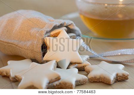 Cinnamon stars christmas cookies and tea cup
