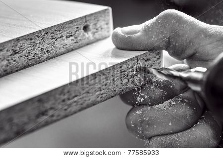 Master screwdriver tightening the screws hands closeup