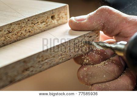 Master screwdriver tightening the screws