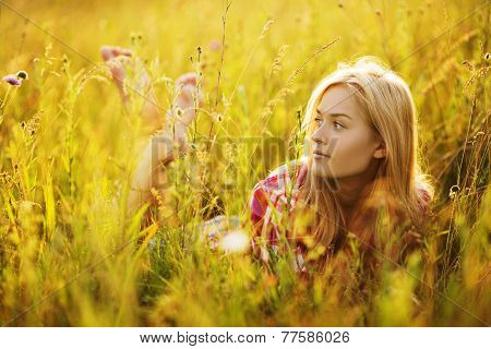 Happy Girl In A Field Of Grass And Flowers