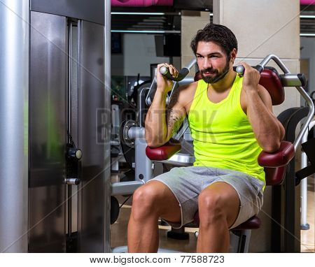 Abdominal crunch machine workout man sit at gym