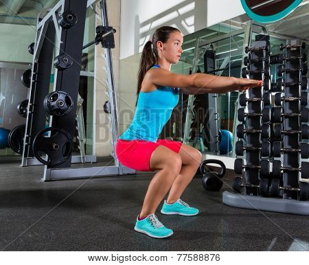Air squat woman workout exercise at gym