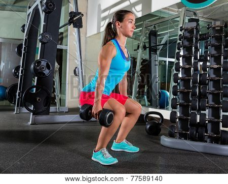 dumbbell squat woman workout exercise at gym