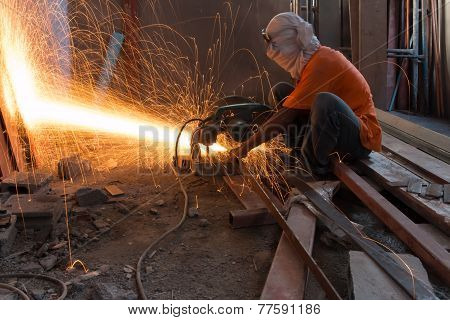 Man Cutting And Welding At Work Shop