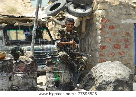 Yemeni military man on duty at the security checkpoint, Hadramaut valley, Yemen.