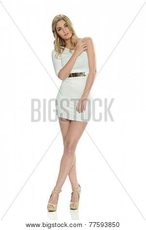 Young Blond woman wearing a short dress isolated on a white background