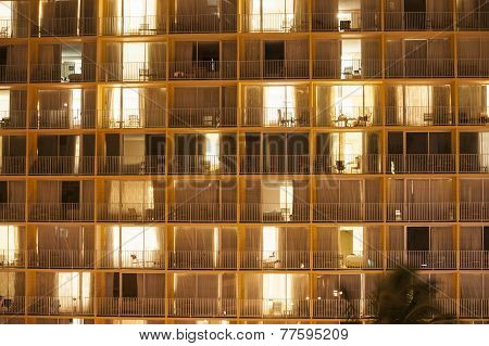 Apartment windows make an architectural abstract at night.