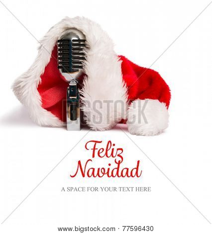 Feliz navidad against vintage mic with santa hat