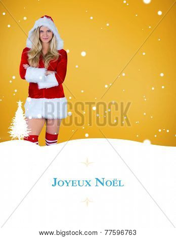 pretty girl in santa outfit with arms crossed against border