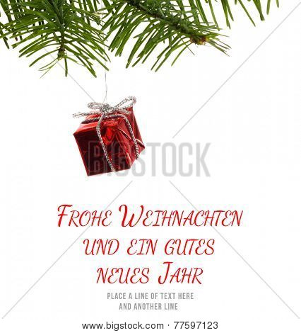 Frohe weihnachten message against red christmas decoration hanging from branch