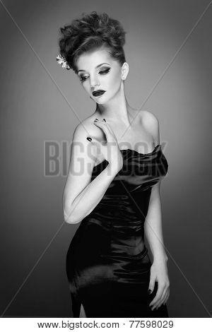 Fashion photo of beautiful lady in elegant evening dress. Black and White