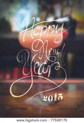 Digitally generated New years message against blurred cocktail