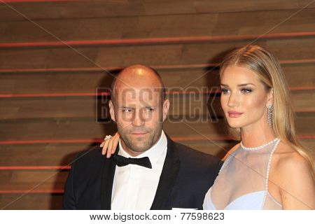 LOS ANGELES - MAR 2:  Jason Statham, Rosie Huntington-Whiteley at the 2014 Vanity Fair Oscar Party at the Sunset Boulevard on March 2, 2014 in West Hollywood, CA