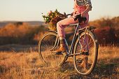 foto of country girl  - Florist girl posing with delivery bike with flower bascket - JPG