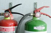 stock photo of fire extinguishers  - Photo of a pair of fire extinguisher - JPG