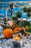 image of tangerine-tree  - Christmas decorations with Christmas tree,candles and tangerines