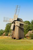 picture of fidget  - Old wooden windmill in the countryside Poland - JPG