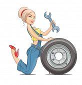 stock photo of dungarees  - Beautiful girl mechanic with wheel - JPG
