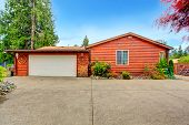 image of log cabin  - Log cabin style house exterior with garage - JPG