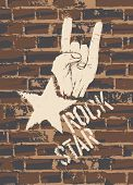 stock photo of rock star  - Rock Star Sign With Horns Gesture On Brick Wall - JPG