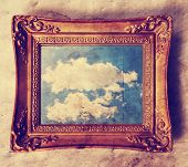 picture of wall cloud  - an antique photo frame with a cloud in it  toned with a retro vintage instagram filter effect  - JPG