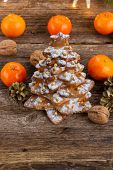 pic of tangerine-tree  - two  gingerbread  tree tangerines on wooden  background - JPG