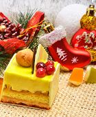 stock photo of cake-ball  - Christmas delicious yellow cake with cranberries on christmas background christmas balls pine twig - JPG