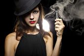 picture of tobacco smoke  - woman smoking or vaping an electronic cigarette to quit tobacco - JPG