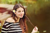 pic of harmony  - cute beautiful woman with chamomile in long hair enjoying harmony of nature near the lake background harmony concept - JPG