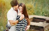 pic of harmony  - happy romantic couple in love and having fun with daisy at the lake outdoor in summer day beauty of nature harmony concept - JPG