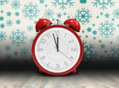 pic of count down  - Alarm clock counting down to twelve against snowflake wallpaper over floor boards - JPG