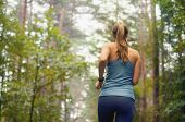foto of morning  - healthy lifestyle fitness sporty woman running early in the morning in forest area fitness healthy lifestyle concept - JPG