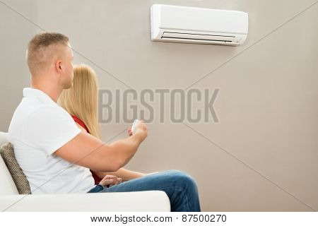 Couple Using Air Conditioner