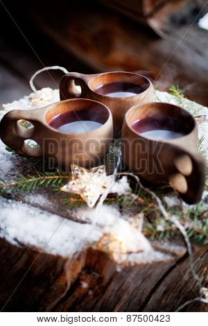 Mulled wine served from kuksa, specially made wooden cup
