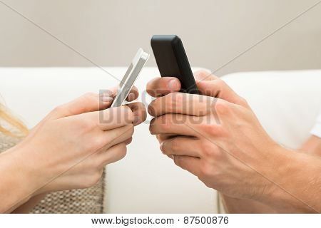Two Hands With Mobile Phone