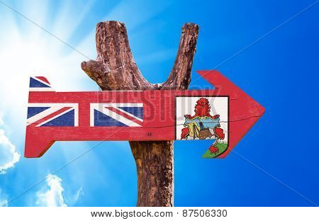 Bermuda Flag wooden sign with sky background
