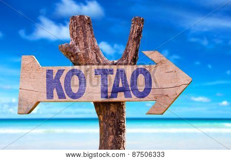 Ko Tao wooden sign with beach background