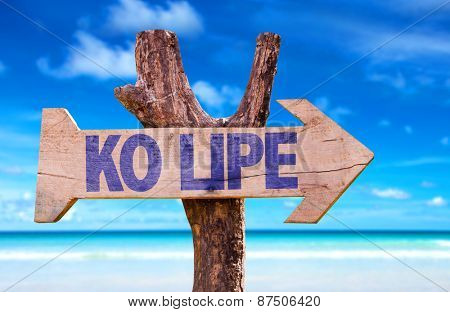 Ko Lipe wooden sign with beach background