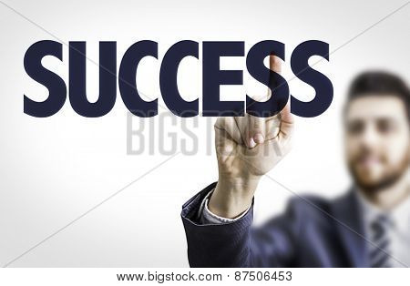 Business man pointing the text: Success