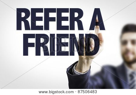 Business man pointing the text: Refer a Friend