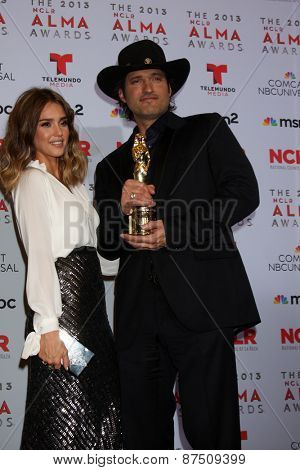 LOS ANGELES - SEP 27:  Jessica Alba, Robert Rodriguez at the 2013 ALMA Awards - Press Room at Pasadena Civic Auditorium on September 27, 2013 in Pasadena, CA
